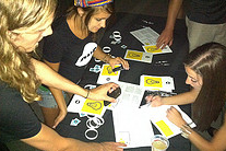 Signing energy petitions in the dark at the St. Louis Maroon 5 show