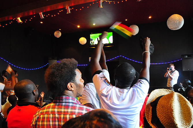 Ghanaians watch the Black Stars play in the FIFA World Cup 2010 in Ghana at a local bar. Photo credit: Wikimedia Commons.
