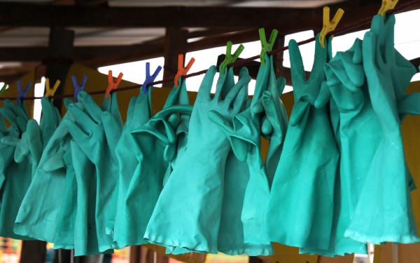 Gloves drying after being disinfected at the Elwa hospital run by French NGO Medecins Sans Frontieres in Monrovia, Liberia during the current Ebola outbreak. Photo by Dominique Faget/Afp/Getty