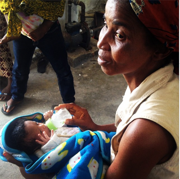 A woman holds her week-old grandson