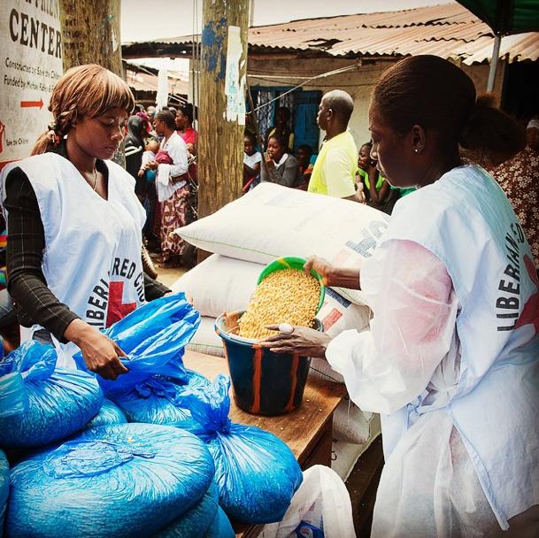 Red Cross volunteers distribute food in Monrovia, Liberia.