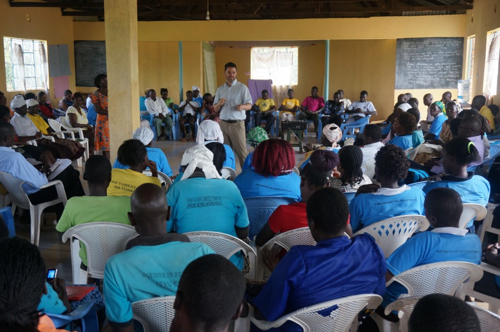Executive Director James Nardella leads an all-staff meeting in Lwala.