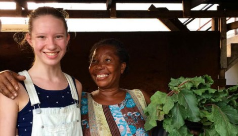 Gracie & Content, a woman who benefits from the Harvest107 microfarm in Haiti