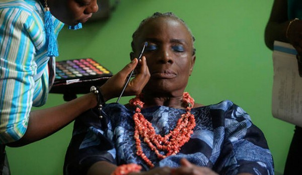 Nigerian actress Taiwo Ajayi-Lycette gets makeup applied before performing a scene. Photo credit: Akintunde Akinleye for Reuters