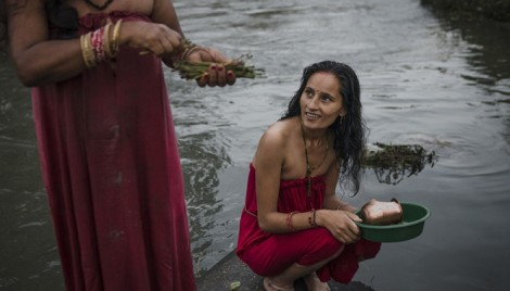 Women observing the ritual intended to wash away sins committed during menstruation at the annual Rishi Panchami festival, Kathmandu, Nepal.  Photo credit: Poulomi Basu/WaterAid