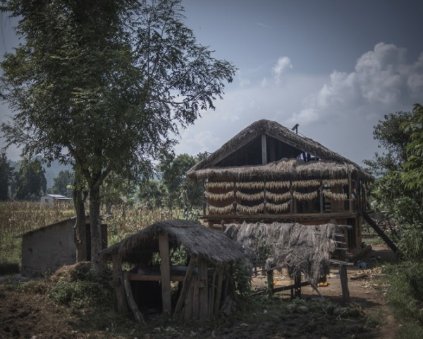 Chhaupadi shed (foreground). These huts are where girls and women are kept during menstruation. 'Chhaupadi' has come to mean 'untouchable menstruating woman.' Narci village, Nepal. Photo credit: Poulomi Basu/WaterAid