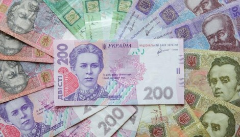 Image: Ukrainian hryvnia banknotes are seen in a photo illustration shot in Kiev, August 6, 2014. REUTERS/Konstantin Chernichkin
