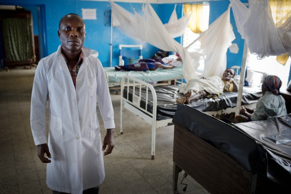 41-year-old nurse Stanley Amos Seyonkon poses for a photograph in his hospital in Buchanan, Liberia, Friday, January 8, 2016. (Photo credit: Jhpiego/Kate Holt)