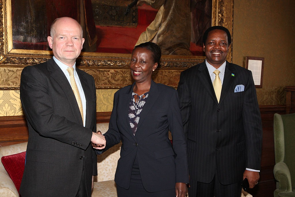 Rwandan Minister of Foreign Affairs Louise Mushikiwabo, center, meets with then-Secretary of State for Foreign Affairs William Hague in 2013. (Photo credit: Foreign and Commonwealth Office/Flickr)