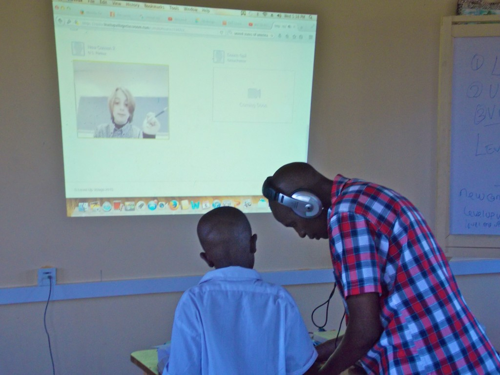 After watching a video message from his partner at New Canaan Country School, this student gets some pointers from Patrick Munguti of Kenya Connect. (Photo credit: Kenya Connect)