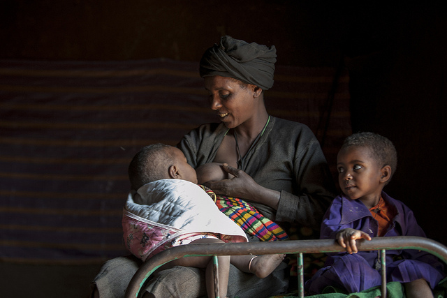Breast Feeding -Yedeneku Aynalem, 38, with her 4 years old daughter Desta and son Barkelegn, 10 month