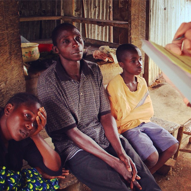 A family answers the questions of an Ebola investigative team member.