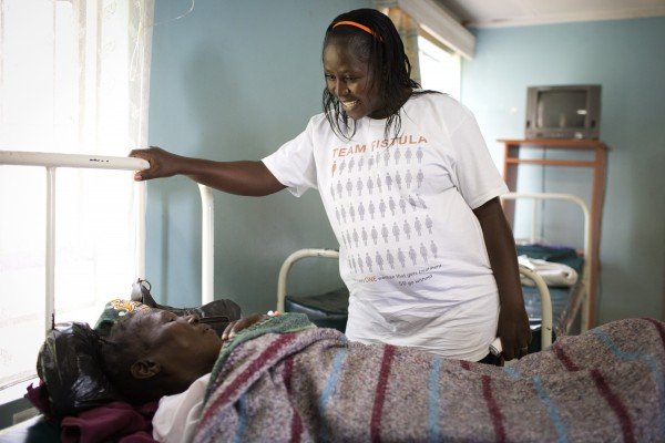 Sarah Omega Kidangasi, 39, talks to a woman suffering from Fistula in a health clinic in Eldoret, Kenya on April 30, 2015. Sarah is an advocate for the Campaign to End Fistula, served as a senior spokesperson with UNFPA, and is Outreach Manager in Western Kenya for One By OneÕs LetÕs End Fistula initiative. She now serves as Communications Officer for the Fistula Foundation Action on Fistula program in Kenya