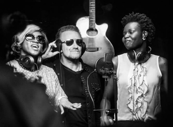 From left: Waje Iruobe, Bono, and Selmor Mtukudzi