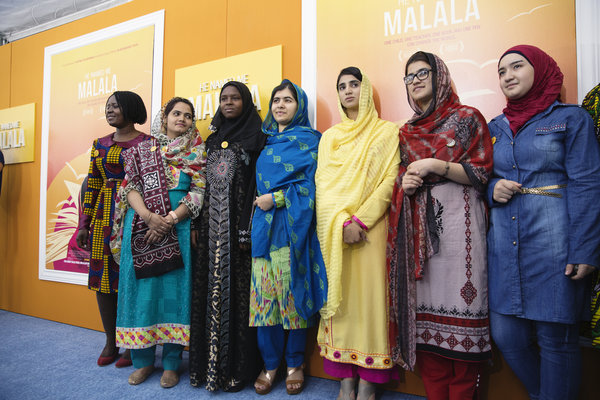 Amina is standing to the right of Malala. Salam is on the right end. Photo credit: Malin Fezehai/HUMAN for Malala Fund