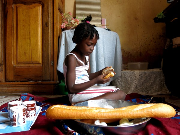 Coumba Ndiaye eats one of her favorite things for breakfast: bread and a peanut butter-based chocolate spread. Photo credit: Ibrahima Thiam