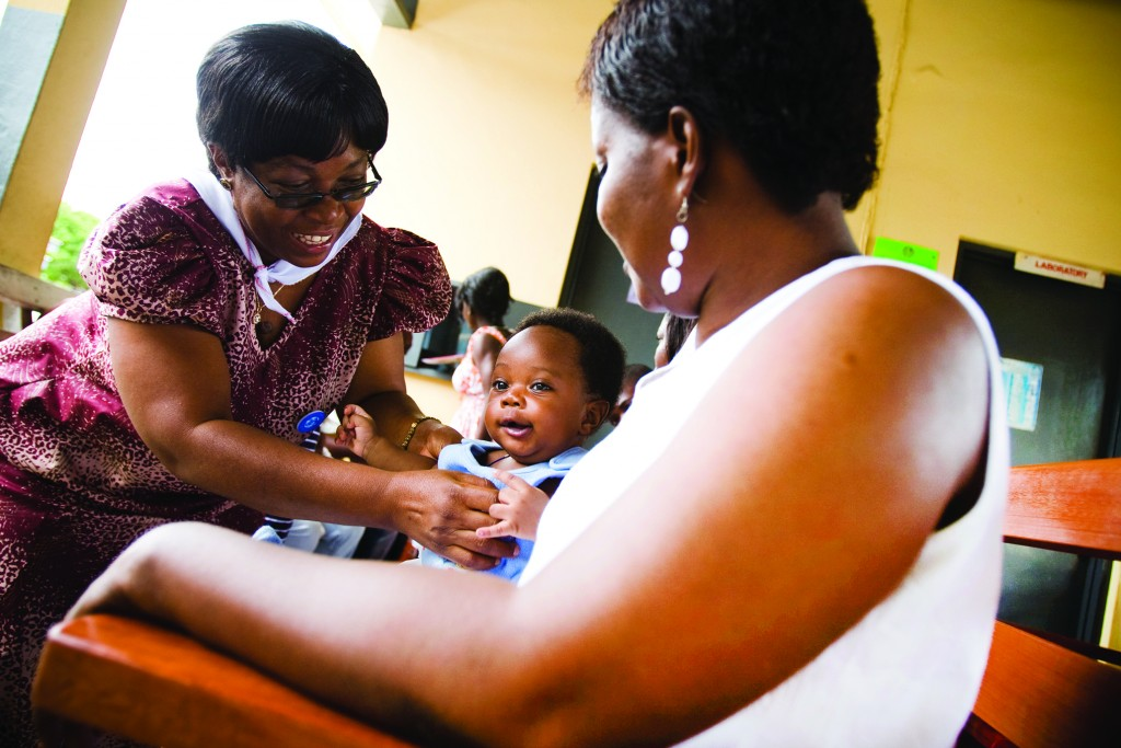 In Ghana, (from left) Veronica Gomez, a GHS breastfeeding program manager; 3-month-old Treasure Abbam; and mother Felicia Owodoo.