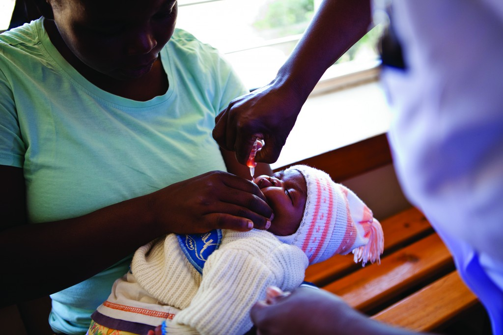 A baby in Kenya receives the polio vaccine.